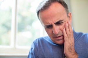 man in pain from dental emergency